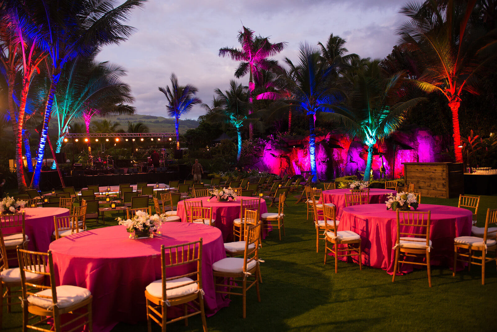 The tropical evening comes alive with brilliant color and lighting.