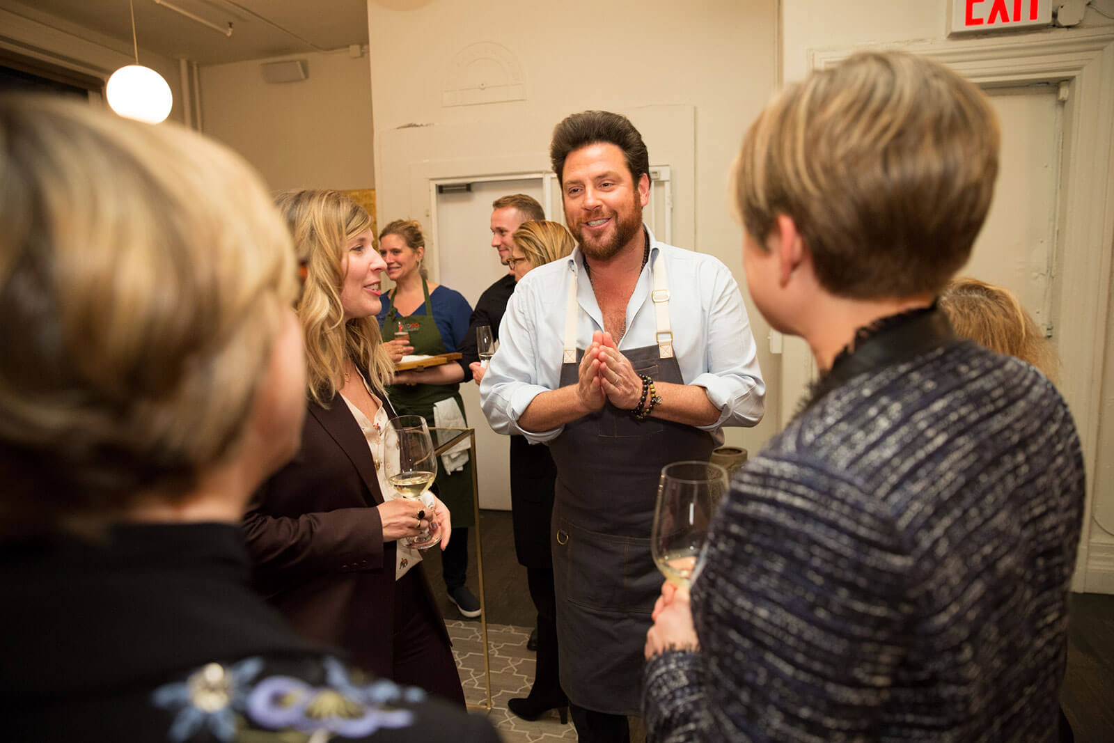 Scott Conant welcomes executives for a signature meal & demo.