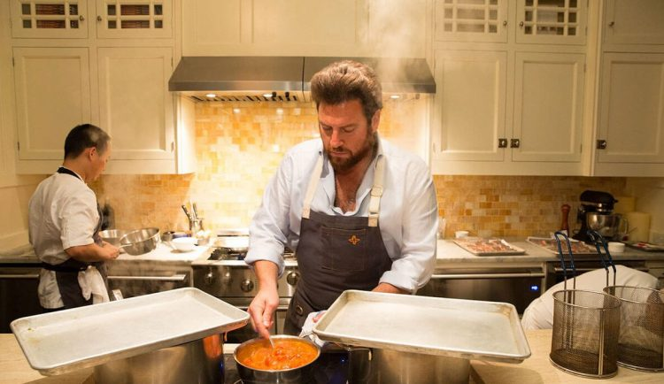 Celebrity Chef Scott Conant prepares an executive dinner in his Culinary Suite.