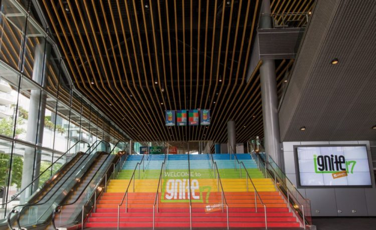 A colorful, branded entrance greets attendees.